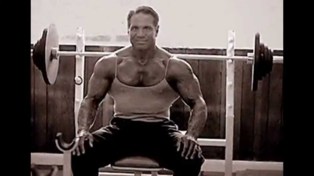 Bill Pearl sitting on bench press